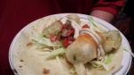 Mezzanine: Tempura avocado taco with sweet chili, cabbage, salsa fresca, & white sauce