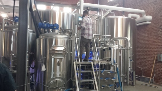 Head brewer James Frazer checks the 3.5bbl pilot system.