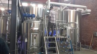 Head brewer James Frazer checks the 3.5bbl pilot system.